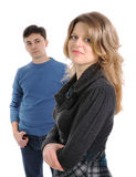 The woman and man. Smiling woman with man in the background Royalty Free Stock Photo