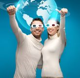 Woman and man in 3d glasses looking at globe model Stock Photos