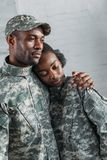 Woman and man in army uniform hugging royalty free stock photos