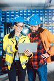 Woman and man as workers in logistics center using computer royalty free stock image