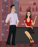 Woman and man at the bar. Beautiful yang woman and handsome man  with a glass of wine standing at the bar Stock Images
