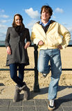 Woman and man on beach stock photography