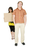 Woman and man bear the big cardboard box Royalty Free Stock Photography