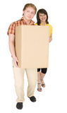Woman and man bear the big cardboard box Stock Images