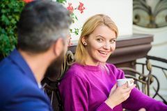 Woman and man with beard relax in cafe. First meet of girl and mature man. Morning coffee. Couple in love on romantic. Woman and men with beard relax in cafe royalty free stock image
