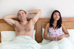 Woman with man in bed Royalty Free Stock Image