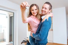 Woman and man being happy in their new house stock photos
