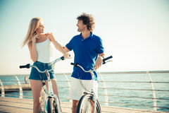 Woman and man on bicycle flirting outdoors. Portrait of a happy women and men on bicycle flirting outdoors Royalty Free Stock Photo