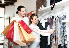 Woman and man at boutique Stock Images
