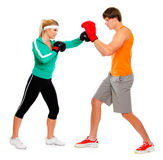 Woman and man in boxing gloves practicing Royalty Free Stock Photos