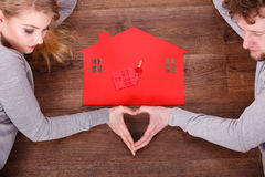 Woman and man bring some love to the new house. Woman and men bring some love to the new house. Hold the symbolic key, move in to their place Stock Photography