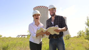 Woman and man builders with blueprints in hands. stock video