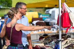 Woman and man buying stuff on flea market Royalty Free Stock Photos