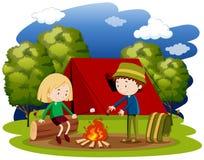 Woman and man camping at night Stock Photos
