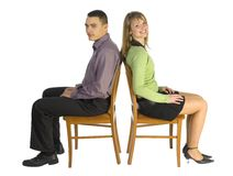 Woman and man on the chairs.