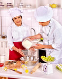 Woman man in chef hat cooking chicken Royalty Free Stock Images