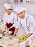 Woman man in chef hat cooking chicken Royalty Free Stock Photography