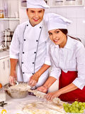 Woman man in chef hat cooking chicken Stock Photos