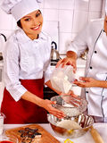 Woman man in chef hat cooking chicken. Royalty Free Stock Images