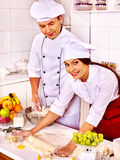 Woman and man in chef hat cooking dough Royalty Free Stock Images