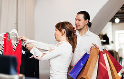 Woman and man  choosing dress at boutique Royalty Free Stock Photography