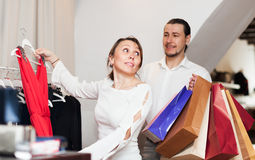 Woman and man  choosing dress at clothing shop Royalty Free Stock Photo
