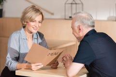 Woman and man choosing food from menu stock photos