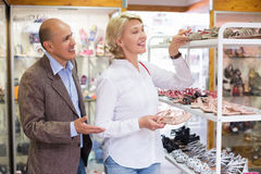 Woman and man choosing shoes Royalty Free Stock Images