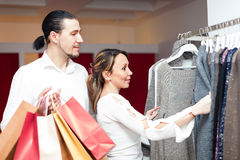 Woman and man  at clothing shop Stock Images