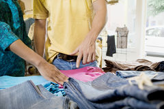 Woman and Man in Clothing Store Stock Images