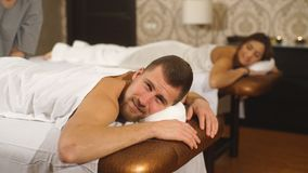 A woman and a man during a couples massage. A happy woman and a man during a couples massage In spa center stock video footage