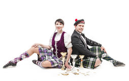 Woman and man dancing Scottish dance with cups and medals Stock Photos