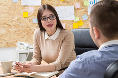 Woman and man discussing project Stock Image