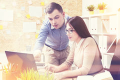 Woman and man discussing project in office Stock Photos