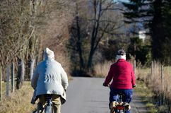 Couple bicycle tour in landscape royalty free stock photography