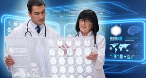 The woman and man doctor looking at mri scan image Stock Image