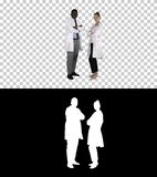 Woman and man doctors with crossed arms, Alpha Channel stock photo
