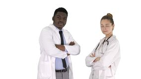Woman and man doctors with crossed arms on white background. stock photography
