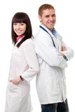Woman and man doctors over white Royalty Free Stock Photos