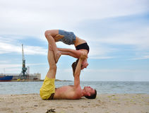Woman and man doing acrobatic yoga Royalty Free Stock Image