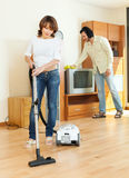 Woman and man doing housework together Stock Photography
