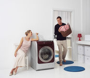 Woman and man doing laundry Royalty Free Stock Images