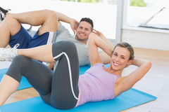 Woman and man doing sits up Stock Photo
