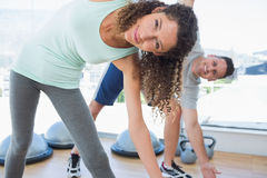 Woman with man doing stretching exercise Stock Image