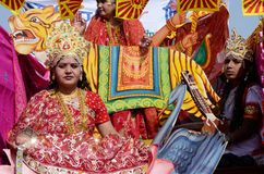 Woman and man dressed as hindu gods at Pushkar camel fair,Rajasthan, India royalty free stock image