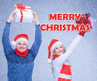 The woman and man dressed in santa hat holding with a Christmas gifts stock images