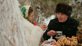 Woman And Man Drinking Tea In The Cold stock footage