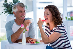 Woman with man eating food Stock Images