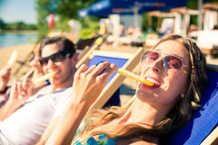 Woman and man eating ice cream on beach Royalty Free Stock Photography