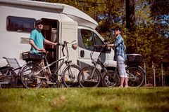 Woman with a man on electric bike resting at the campsite. Stock Images